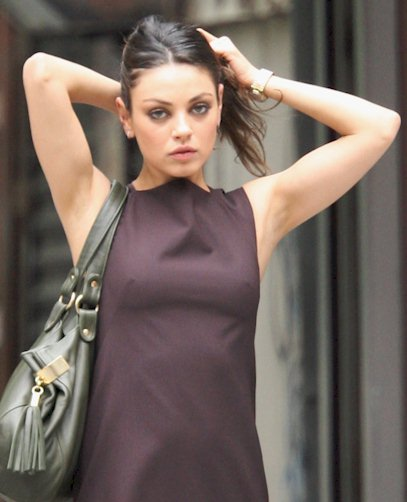 Here's Mila Kunis on the set of Friends with Benefits and looking at ...
