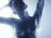 Miley Cyrus in Silver Body Paint for New Video