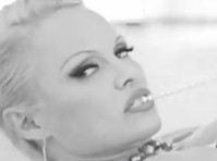 Pamela Anderson Strips for PETA