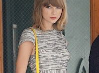 Taylor Swift is Leggy in a Short Skirt!