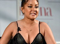 Adrienne Bailon's Cleavage in a Leather Dress!