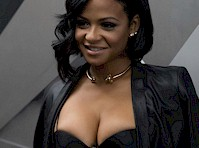 Christina Milian in a Bra and Leather Skirt!