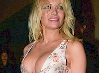 Pamela Anderson Busting Out at Catch!