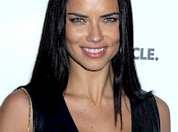 Adriana Lima Cleavage in a Leather Dress!