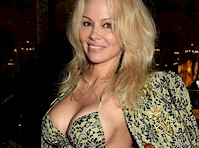 <em>Pamela Anderson</em> Cleavage at <em>Paris Fashion Week!</em>